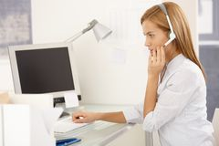 Customer service worker with headset Royalty Free Stock Image