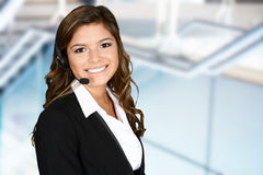 Customer Service. Young woman giving help as a customer service employee Stock Photography