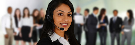 Customer Service. Young women giving help as a customer service employee Royalty Free Stock Image