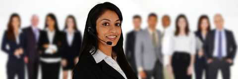 Customer Service. Young women giving help as a customer service employee Royalty Free Stock Images