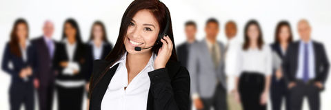 Customer Service. Young women giving help as a customer service employee Stock Photos
