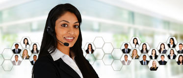 Customer Service. Young women giving help as a customer service employee Stock Photography