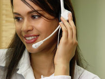 Customer services. Latin operator with headset, attending a phone call Stock Photography