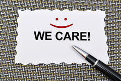 Customer Services we care with a smile sign.  Stock Photography