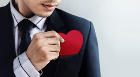Customer services concept, businessman dropping a heart paper c Stock Image