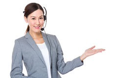 Customer services consultant with hand presentation Stock Photos