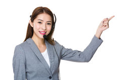 Customer services officer with finger point upwards Royalty Free Stock Images