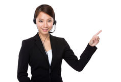 Customer services operator with finger point up Stock Photos