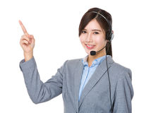 Customer services operator and finger point up Stock Photos