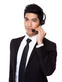 Customer services operator holding with microphone Stock Image