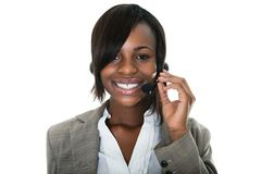 Customer services representative. Portrait of smiling  female customer services representative on white background Royalty Free Stock Photography
