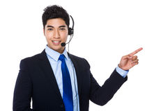 Customer services representative with finger point up Royalty Free Stock Photography