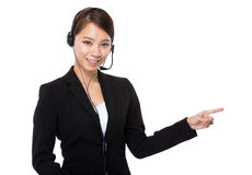 Customer services representative with finger up Royalty Free Stock Image