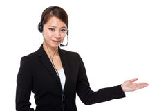 Customer services representative with open hand palm Stock Image