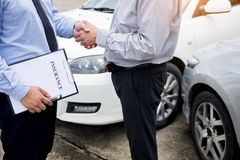 Customer shake hand with auto insurance agents after agreeing to. Terms of insurance Royalty Free Stock Photography
