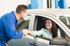 Customer shaking hands with mechanic Royalty Free Stock Photography