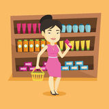 Customer with shopping basket and tube of cream. Royalty Free Stock Image