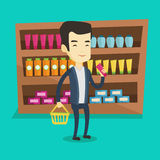 Customer with shopping basket and tube of cream. Royalty Free Stock Photo