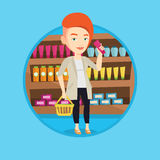 Customer with shopping basket and tube of cream. Stock Image