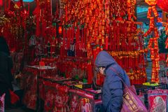 A customer is shopping for Chinese New Year decorations in a store in Chinatown, as the Chinese Lunar New Year, the year of the royalty free stock images