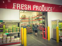 Customer shopping at Costco Wholesale fresh produce department