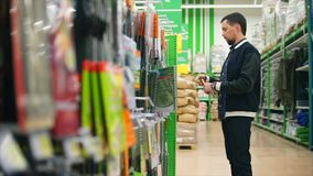 Customer shopping in department of leisure goods stock footage