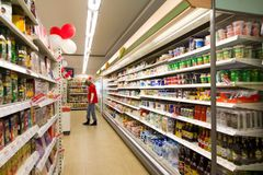 Customer shopping in grocery store Royalty Free Stock Photo