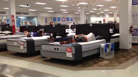 Customer shopping mattress. Insdie Sears store stock video footage