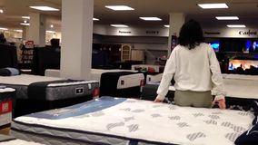 Customer shopping mattress inside Sears store. In Burnaby BC Canada stock footage