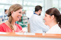 Customer shopping in pharmacy or drug store Royalty Free Stock Image