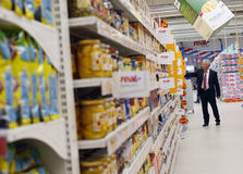 Customer shopping at supermarket Stock Images