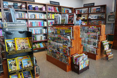 Customer shops for books in Phnom Penh Airport, Cambodia. Stock Photography
