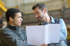 Customer showing details to welder Stock Images