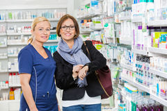 Customer Showing Medicine Information To Stock Photography