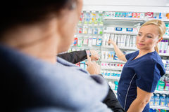 Customer Showing Smartwatch To Mature Pharmacist Royalty Free Stock Photo