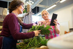 Customer Showing Something On Digital Tablet To Royalty Free Stock Image