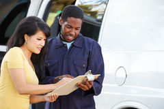 Customer Signing For Delivery From Courier Royalty Free Stock Photography