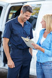 Customer Signing For Delivery From Courier Stock Photography