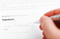 Customer signing sales contract by silver pen Stock Photos