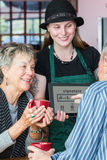 Customer Signs Tablet to Pay in Coffee House Stock Photography