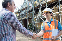 Customer On Site Shaking Hands With Builder. Customer On Site Shakes Hands With Builder Stock Photos