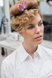 Customer sitting with curlers in hair Royalty Free Stock Images