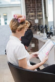 Customer sitting with curlers in hair Stock Images