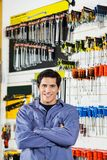 Customer Standing Arms Crossed In Hardware Shop Royalty Free Stock Photos