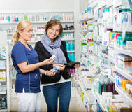 Customer Standing By Chemist Showing Medicines In Stock Photography