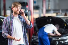 Customer standing in garage Stock Image