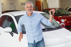 Customer standing while holding car key Stock Images