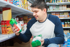 Customer standing near shelves with food Royalty Free Stock Photography
