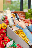 Customer in supermarket scanning royalty free stock images
