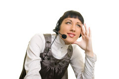 Customer support. Girl with headphones thinking about something Stock Photography